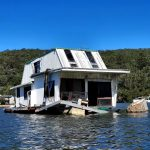 Close up of the houseboat with extensive damage