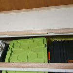 Master cabin under bed storage with crates of stuff