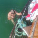 Robert diving to remove rope around propeller