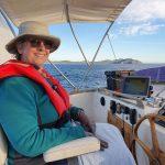 Staying warm near Charlotte Head & steering with my feet!