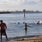 Families enjoying the water