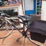 I swapped the rear basket for panniers, since I had trouble getting my leg over!
