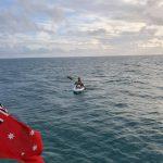 Me kayaking back after retrieving the fender