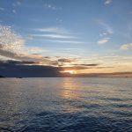 Sun setting across Tinonee Bank