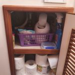 Bathroom cupboard under sink. Yes it's a bit messy but it's OK not to be prefect!