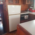 Galley showing fridge/microwave/hotplates