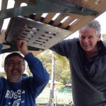 Robert and friend Paul re-installing the swim ladder