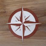Close of up compass rose, each piece has been cut separately
