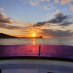 Sun rising behind Lion Island
