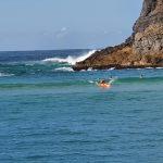 Surfing at Sugarloaf Bay