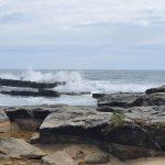 Waves crashing over rocks!