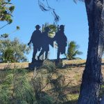 Silhouetted figures of Australian soldiers