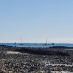 Boats on anchor, Poseidon on the right