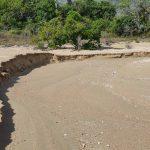 Sand erosion along the beach